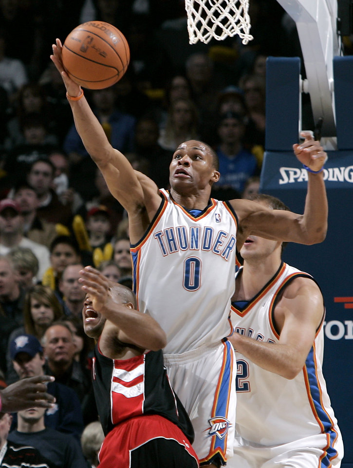 Photo - Oklahoma City's Russell Westbrook gets a steal from Toronto's Jarrett Jack during their NBA basketball game at the Ford Center in Oklahoma City on Sunday, Feb. 28, 2010. Photo by John Clanton, The Oklahoman