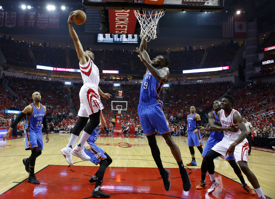 Photo -  Houston's Eric Gordon dunks over Oklahoma City's Jerami Grant  in Houston. [Photo by Sarah Phipps, The Oklahoman]