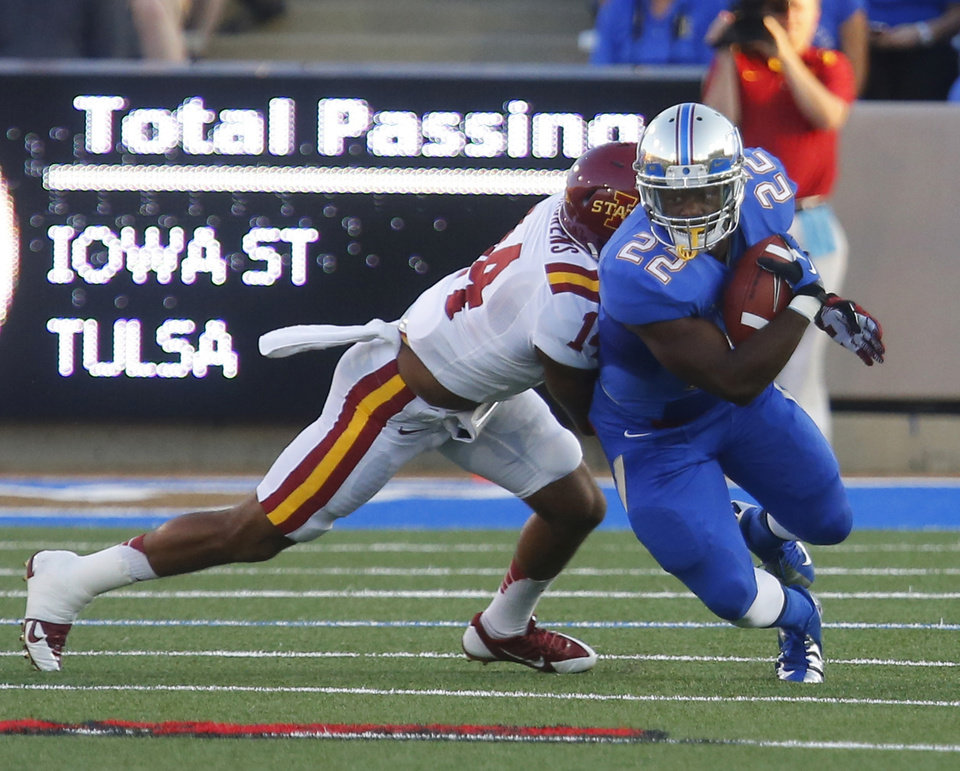 Photo - Tulsa's Trey Watts (22) is taken down by Iowa State's Jared Brackens during the first half of an NCAA college football game, Thursday, Sept. 26, 2013 in Tulsa, Okla. (AP Photo/Tulsa World,  Tom Gilbert)  ONLINE OUT; TV OUT; TULSA OUT