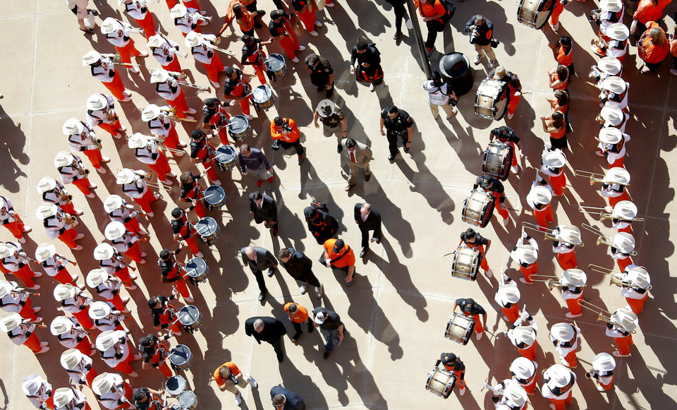 Photo - Fans cheer as Oklahoma State head coach Mike Gundy walks in the stadium during the Spirit Walk before the college football game between Oklahoma State University and Baylor at Boone Pickens Stadium in Stillwater, Okla., Saturday, Oct. 19, 2019. [Sarah Phipps/The Oklahoman]