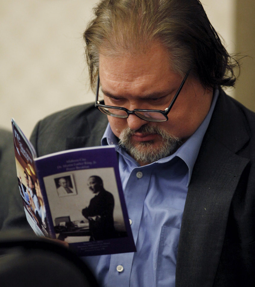 Photo - A guest looks at the souvenir program during the 16th annual Midwest City Dr. Martin Luther King, Jr. Prayer Breakfast inside the Reed Conference Center Monday morning, Jan. 21, 2013. The theme of this year's event is