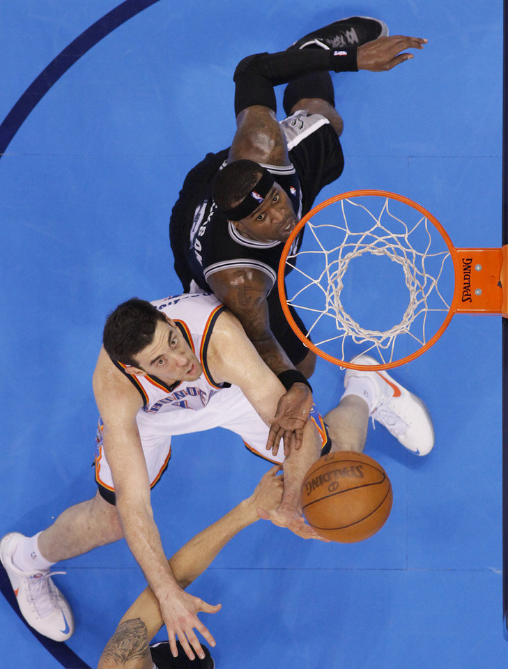 Photo - Oklahoma City's Nick Collison (4) battles under the basket with San Antonio's Stephen Jackson (3) during Game 6 of the Western Conference Finals between the Oklahoma City Thunder and the San Antonio Spurs in the NBA playoffs at the Chesapeake Energy Arena in Oklahoma City, Wednesday, June 6, 2012. Photo by Chris Landsberger, The Oklahoman