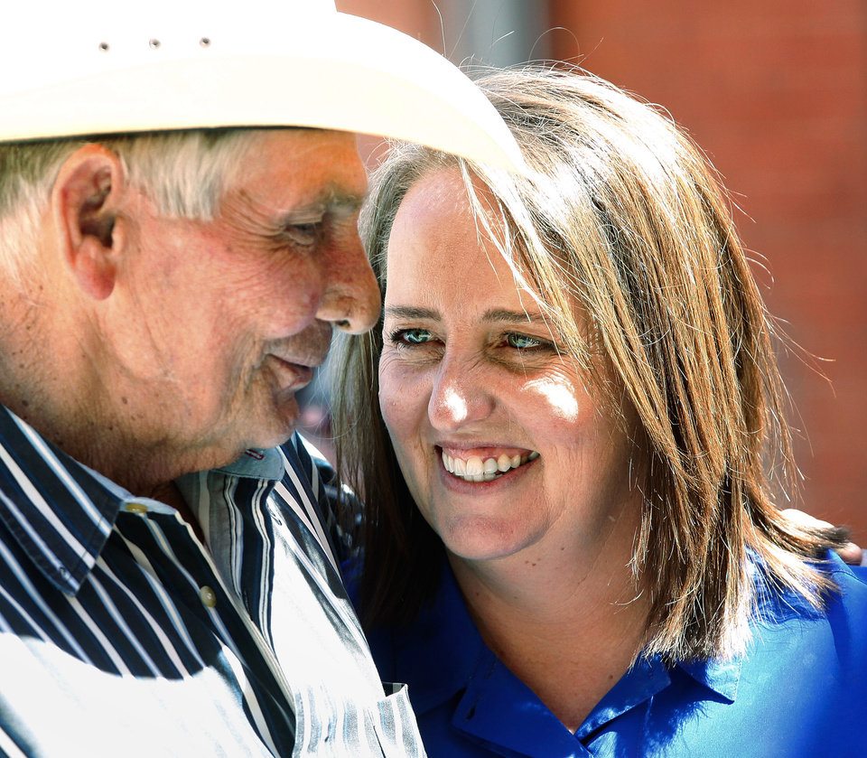 Bobbi Parker smiles after receiving a supportive hug from her father-in-law, Jerry Parker outside the courthouse Tuesday afternoon. The first full day of jury deliberations began Tuesday, Sep. 20, 2011. after closing arguments were completed in the trial of Bobbi Parker late Monday night. The trial is in the Greer County Courthouse in Mangum, Okla. Photo by Jim Beckel, The Oklahoman