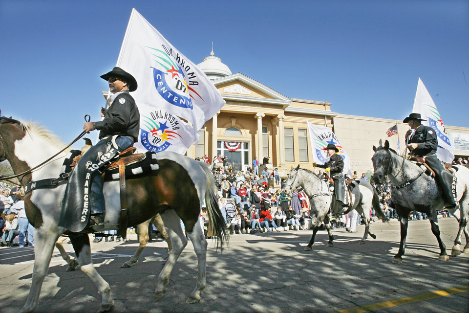 Photo - The Lawton Rangers ride past the Carnegie Library in the Centennial Parade in Guthrie, Friday, November 16, 2007.  By David McDaniel, The Oklahoman
