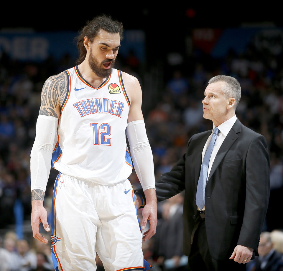 Photo - Oklahoma City's Steven Adams (12) talks with coach Billy Donovan during an NBA basketball game between the Oklahoma City Thunder and the Miami Heat at Chesapeake Energy Arena in Oklahoma City, Monday, March 18, 2019. Photo by Bryan Terry, The Oklahoman