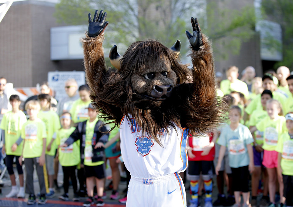 Photo - Rumble leads children in exercises before the kids marathon during the Oklahoma City Marathon in Oklahoma City,  Sunday, April 29, 2018. Photo by Sarah Phipps, The Oklahoman