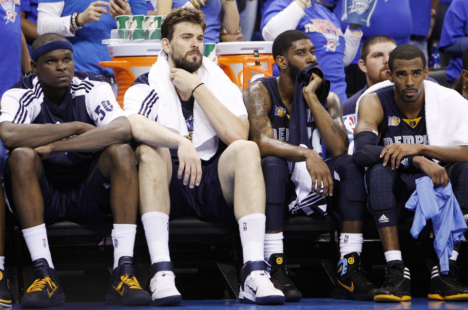 From left, Zach Robinson (50), Marc Gasol (33), O.J. Mayo (32) and Mike Conley (11) of Memphis sit on the bench late in the fourth quarter during game 7 of the NBA basketball Western Conference semifinals between the Memphis Grizzlies and the Oklahoma City Thunder at the OKC Arena in Oklahoma City, Sunday, May 15, 2011. The Thunder won, 105-90. Photo by Nate Billings, The Oklahoman
