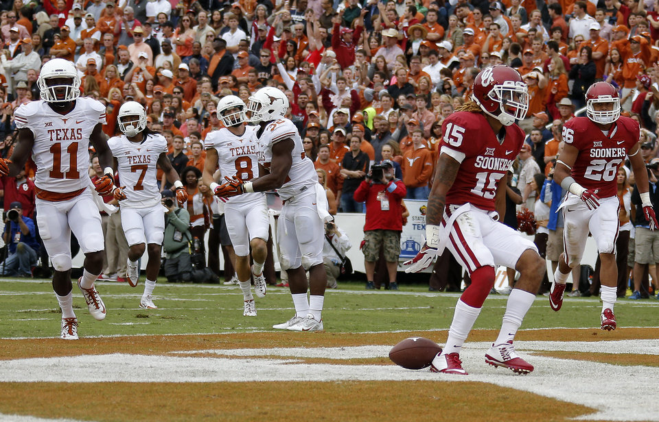 Photo - Oklahoma's Zack Sanchez (15) returns an interception for a touchdown during the Red River Showdown college football game between the University of Oklahoma Sooners (OU) and the University of Texas Longhorns (UT) at the Cotton Bowl in Dallas on Saturday, Oct. 11, 2014. 