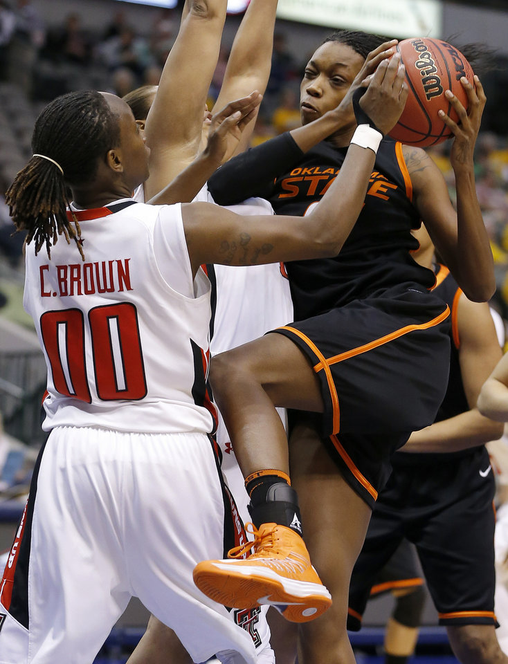 Oklahoma State\'s Toni Young (15) tries to get past Texas Tech\'s Chynna Brown (00) during the Big 12 tournament women\'s college basketball game between Oklahoma State University and Texas Tech University at American Airlines Arena in Dallas, Saturday, March 9, 2012. Oklahoma State won 59-54. Photo by Bryan Terry, The Oklahoman