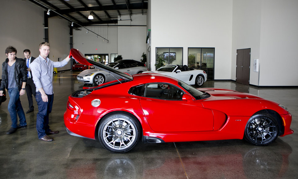 Photo - In this Wednesday, March, 26, 2014 photo, Michael Clark, 22, left,  and Douglas Sawyer, 23, right, both from Chicago rent a 2013 Dodge Viper at the Enterprise Exotic Car Collection showroom near Los Angeles International Airport. (AP Photo/Damian Dovarganes)