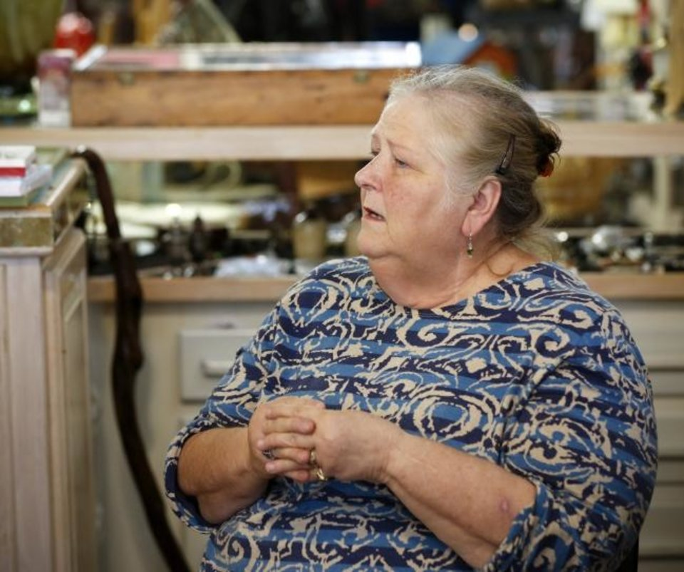 Photo -  Janet Keith, co-owner and manager of the Best Door on Dallas, talks Wednesday about the effects of drugs on small towns, while in her shop in Talihina. [Nate Billings/The Oklahoman]
