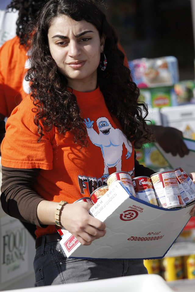 Lara Keddissi helps load food collected for the Regional Food Bank of Oklahoma at Bishop McGuinness High School Friday, November 9, 2012.  The school collected 75,660 pounds of food. Photo by Doug Hoke, The Oklahoman