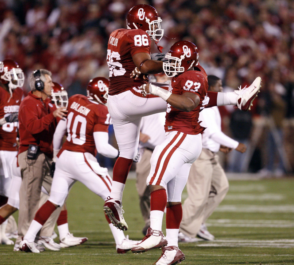 Photo - OU's Adrian Taylor (86)  and Gerald McCoy celebrate a stop during the first half of the college football game between the University of Oklahoma Sooners and Texas Tech University at the Gaylord Family -- Oklahoma Memorial Stadium on Saturday, Nov. 22, 2008, in Norman, Okla.   BY STEVE SISNEY, THE OKLAHOMAN