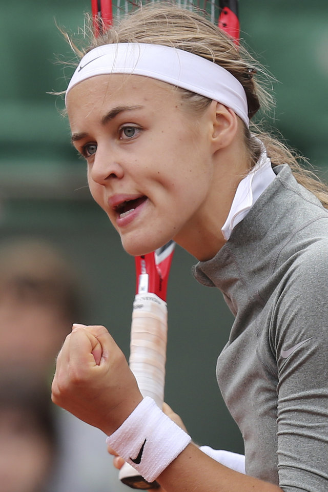 Photo - Slovakia's Anna Schmiedlova clenches her fist when scoring a point during the second round match of the French Open tennis tournament against Venus Williams of the U.S. at the Roland Garros stadium, in Paris, France, Wednesday, May 28, 2014. (AP Photo/David Vincent)