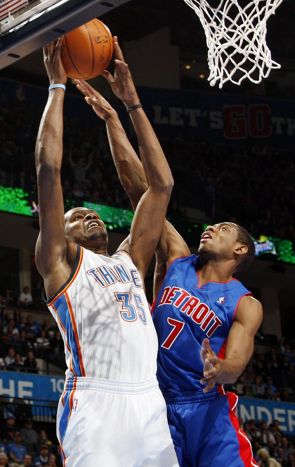 Photo - Oklahoma City's Kevin Durant (35) shoots as Brandon Knight (7) defends for Detroit during the NBA basketball game between the Detroit Pistons and Oklahoma City Thunder at the Chesapeake Energy Arena in Oklahoma City, Monday, Jan. 23, 2012. Photo by Nate Billings, The Oklahoman