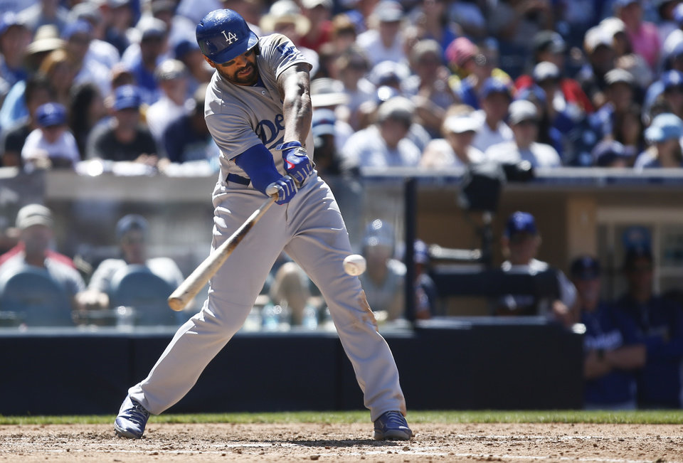 Photo - Los Angeles Dodgers' Matt Kemp hits a single to center to drive in Hanley Ramirez in the fifth inning of a baseball game against the San Diego Padres, Sunday, Aug. 31, 2014, in San Diego. (AP Photo/Lenny Ignelzi)