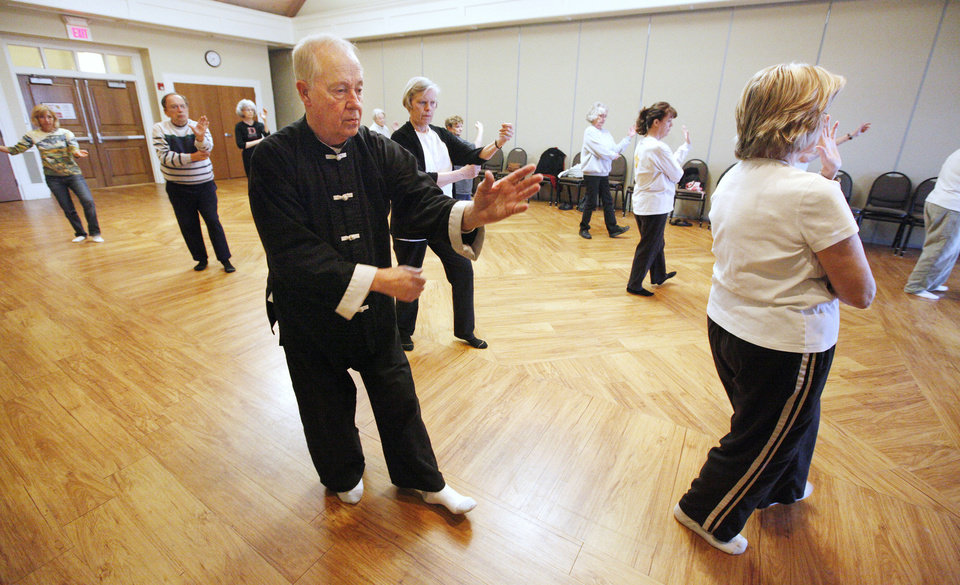 Photo - Instructor David Kamphaus, center, leads a tai chi class for seniors at the Edmond Senior Center. PHOTOS BY PAUL B. SOUTHERLAND, THE OKLAHOMAN