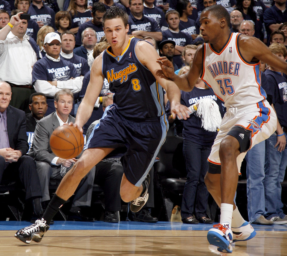 Denver's Danilo Gallinari (8) drives past Oklahoma City's Kevin Durant (35)during the NBA basketball game between the Denver Nuggets and the Oklahoma City Thunder in the first round of the NBA playoffs at the Oklahoma City Arena, Wednesday, April 27, 2011. Photo by Sarah Phipps, The Oklahoman