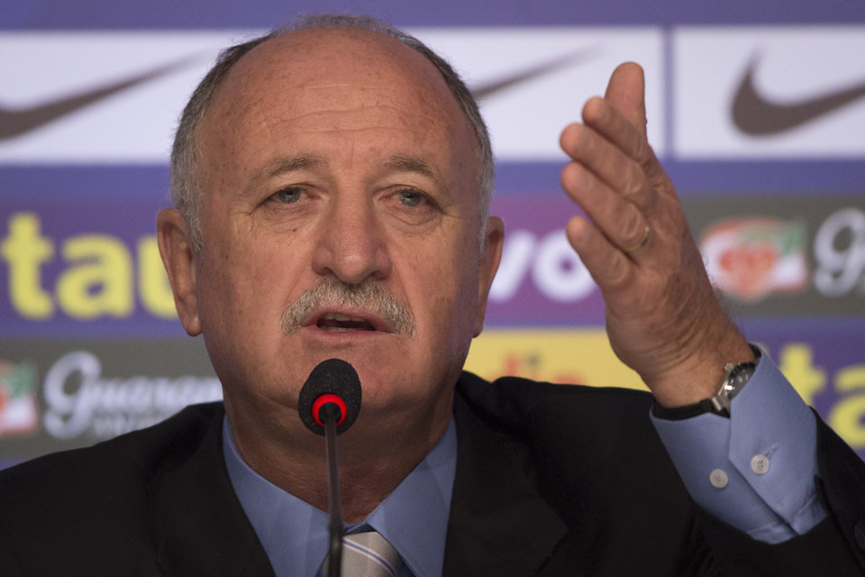Photo - Brazil's soccer coach Luiz Felipe Scolari announces his list of players for the 2014 Soccer World Cup during a news conference in Rio de Janeiro, Brazil, Wednesday, May 7, 2014. (AP Photo/Felipe Dana)