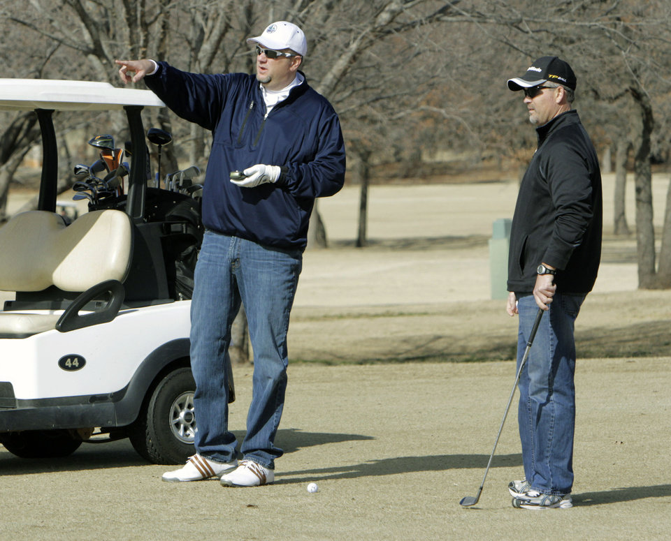 Troy Rasp (left) and Steve Davenport look at their next shot during the 14th annual two-man Ironman golf tournament at KickingBird Golf Course in Edmond, OK, Saturday, Jan. 28, 2012. By Paul Hellstern, The Oklahoman
