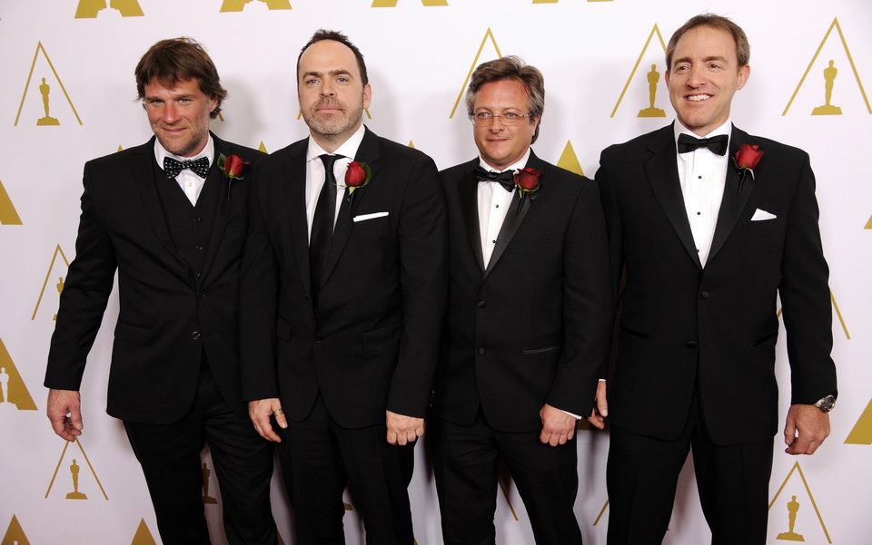 Photo - Left to right, Robert Lanciault, Andre Gauthier, Benoit Sevigny and Yves Boudreault, designers of the FILMBOX software application and recipients of a Scientific and Engineering Award, pose together at the Academy of Motion Picture Arts and Sciences' annual Scientific and Technical Awards on Saturday, Feb. 15, 2014, in Beverly Hills, Calif. (Photo by Chris Pizzello/Invision/AP)
