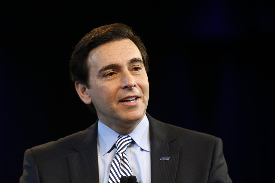 Photo - Ford Motor Company Chief Operating Officer Mark Fields speaks during a news conference in Dearborn, Mich., Thursday, May 1, 2014. Ford announced Fields will replace CEO Alan Mulally, who is retiring July 1. (AP Photo/Paul Sancya)
