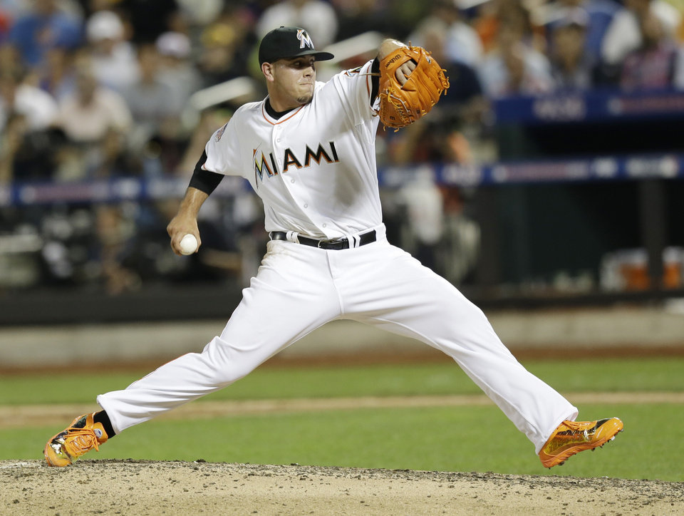 Photo - National League's Jose Fernandez, of the Miami Marlins, pitches during the sixth inning of the MLB All-Star baseball game, on Tuesday, July 16, 2013, in New York. (AP Photo/Kathy Willens)