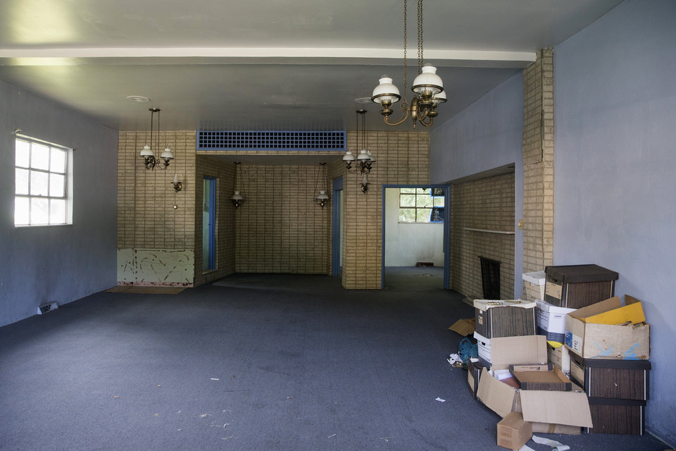 Photo - A view of the inside of the former Minus Funeral Home in Dover, Del., Thursday, Aug. 7, 2014, where police say the cremated remains of nine victims of a 1978 mass cult suicide-murder in Jonestown, Guyana, were discovered. The state Division of Forensic Science has taken possession of the remains, discovered at the former Minus Funeral Home in Dover, and is working to make identifications and notify relatives, the agency and Dover police said in a statement. The division last week responded to a request to check the former funeral home after 38 containers of remains were discovered inside. Thirty-three containers were marked and identified.  They spanned a period from about 1970 to the 1990s and included the Jonestown remains.  (AP Photo/Evan Vucci)