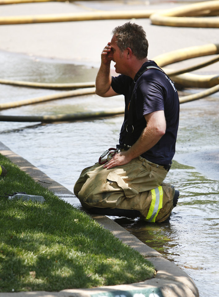 An Oklahoma City firefighter cools off after battling a house fire on west Rossmore Place in Oklahoma City, Oklahoma , Wednesday, June 8, 2011. Photo by Steve Gooch