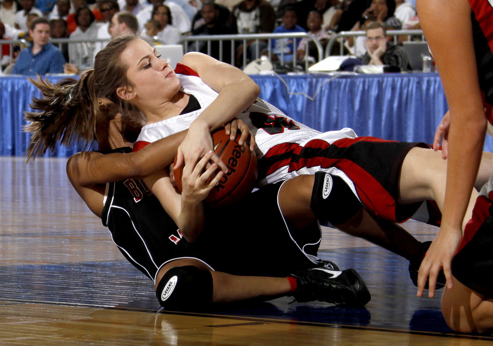 Photo - Frontier's Christina Ingmire, top, fights with Boynton-Moton's Tamara Thomas during the Class B girls basketball state tournament at the State Fair Arena in Oklahoma City, Friday, March 5, 2010.  Photo by Bryan Terry, The Oklahoman