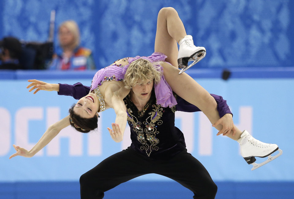 Photo - Meryl Davis and Charlie White of the United States compete in the ice dance free dance figure skating finals at the Iceberg Skating Palace during the 2014 Winter Olympics, Monday, Feb. 17, 2014, in Sochi, Russia. (AP Photo/Darron Cummings)