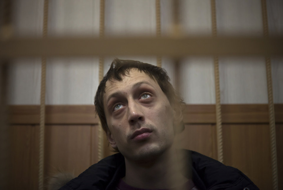 Photo - Bolshoi soloist Pavel Dmitrichenko listens in a courtroom in Moscow, Russia, Thursday, March 7, 2013. The star dancer accused of masterminding the attack on the Bolshoi ballet chief acknowledged Thursday that he gave the go-ahead for the attack, but said he did not order anyone to throw acid on the artistic director's face. Dmitrichenko told a Moscow court that he had complained about ballet chief Sergei Filin to an acquaintance, who offered to