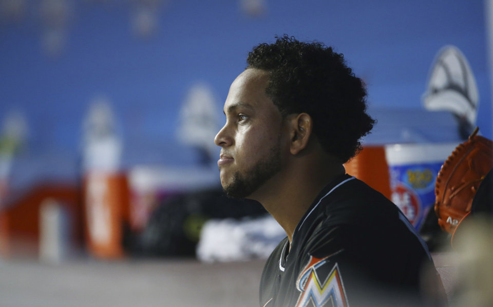 Photo - Miami Marlins starter Henderson Alvarez sits in the dugout during a baseball game against theSeattle Mariners in Miami, Saturday, April 19, 2014.  (AP Photo/J Pat Carter)