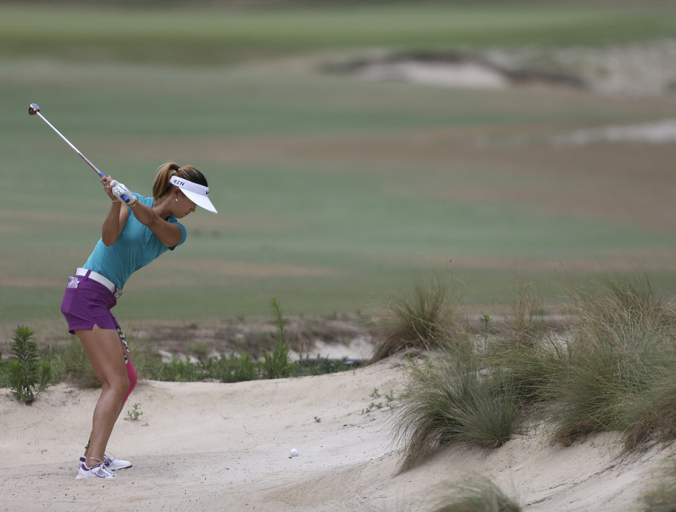 Photo - Michelle Wie prepares to hit from a sand trap on the fourth hole during the final round of the U.S. Women's Open golf tournament in Pinehurst, N.C., Sunday, June 22, 2014. (AP Photo/Bob Leverone)