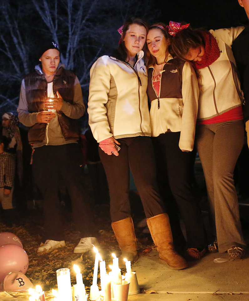 Photo - Danvers High School students hold a candlelight vigil to mourn the death of Colleen Ritzer, a 24-year-old math teacher at Danvers High School, on Wednesday, Oct 23, 2013, in Danvers, Mass. Ritzer's was found in woods behind the high school, and Danvers High School student Philip Chism, 14, who was found walking along a state highway overnight, was charged with killing her. (AP Photo/ Bizuayehu Tesfaye)