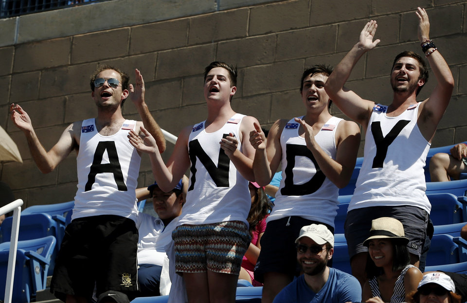 Photo - Tennis fans cheer for Andy Murray, of the United Kingdom, during the opening round of the 2014 U.S. Open tennis tournament, Monday, Aug. 25, 2014, in New York. (AP Photo/Kathy Willens)