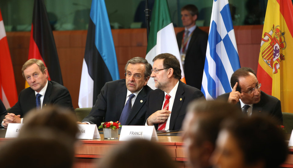 Photo - Greek Prime Minister Antonis Samaras, center left, speaks with Spanish Prime Minister Mariano Rajoy, center right, during a signing ceremony at an EU summit in Brussels on Friday, June 27, 2014. The Ukrainian President Petro Poroshenko has signed up to a trade and economic pact with the European Union, saying it may be the