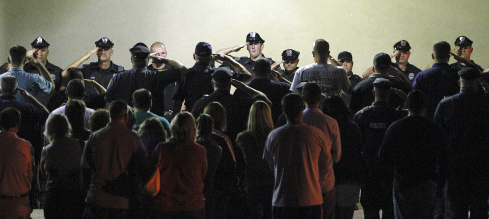 Photo -   Police gather to salute the body of slain Plymouth Township canine officer Brad Fox, on Thursday Sept. 13, 2012, at Montgomery Hospital in Norristown Pa. The officer was shot and killed while responding to a hit-and-run in a Philadelphia suburb, authorities said. (AP Photo/ Joseph Kaczmarek)