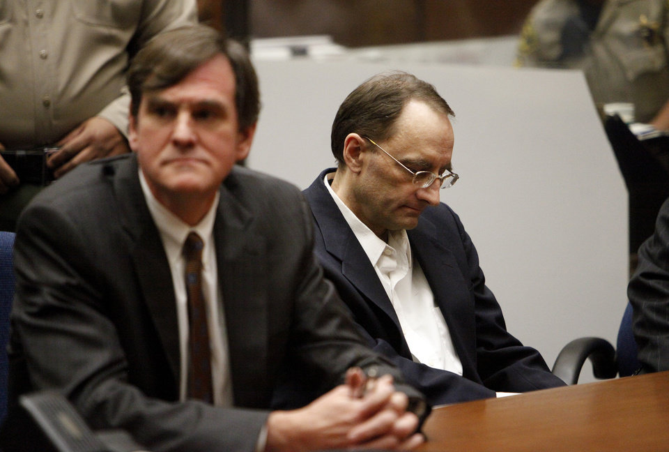 Photo - Christian Gerhartsreiter,  right, listens as verdict is reached at the Clara Shortridge Foltz Criminal Justice Center in Los Angeles Wednesday, April 10, 2013.  The jury found Gerhartsreiter guilty in the death of a California man nearly three decades ago.  The verdict was reached Wednesday after the jury deliberated about a day.  Testimony in the cold-case trial of Gerhartsreiter focused on the discovery of the bones of John Sohus long after he and his wife disappeared from his mother's home in San Marino, a wealthy Los Angeles suburb.  The defendant, a German immigrant with delusions of grandeur, rented a cottage at the Sohus home in 1985 then disappeared about the same time as Sohus and his wife Linda who was never found.  (AP Photo/Los Angeles Times, Al Seib)  NO FORNS; NO SALES; MAGS OUT; ORANGE COUNTY REGISTER OUT; LOS ANGELES DAILY NEWS OUT; VENTURA COUNTY STAR OUT; INLAND VALLEY DAILY BULLETIN OUT; MANDATORY CREDIT, TV OUT