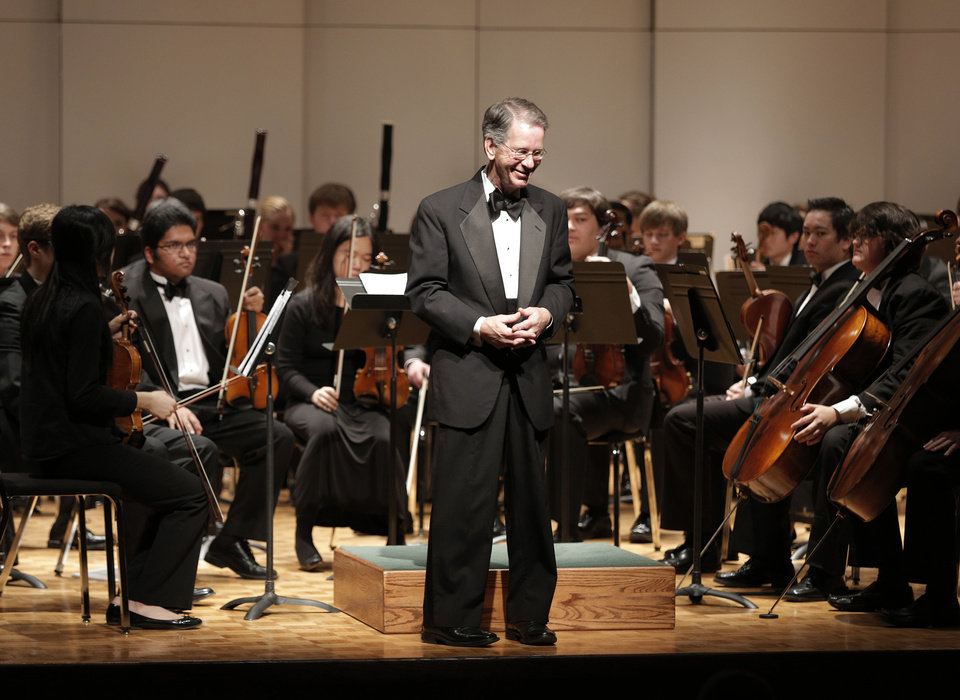 John E. Clinton, conductor of the Oklahoma Youth Orchestra, smiles after finishing a piece during a Winter Concert performance at Petree Recital Hall at Oklahoma City University on Sunday. PHOTO BY GARETT FISBECK, FOR THE OKLAHOMAN <strong>Garett Fisbeck - Garett Fisbeck</strong>