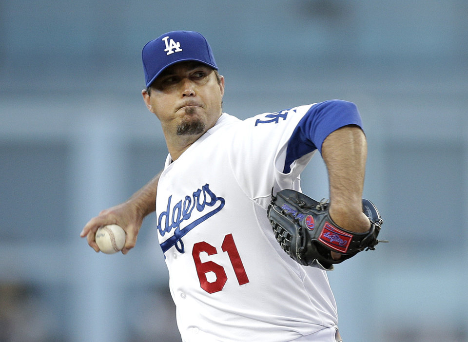 Photo - Los Angeles Dodgers starting pitcher Josh Beckett throws against the Pittsburgh Pirates during the first inning of a baseball game Friday, May 30, 2014, in Los Angeles. (AP Photo/Jae C. Hong)