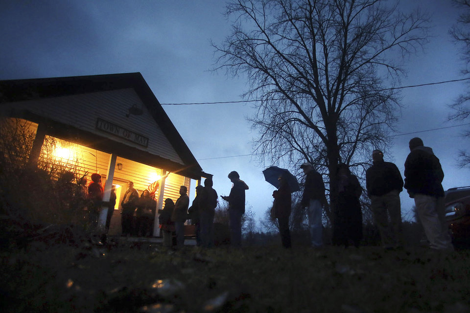 Photo -   Voters wait for the polling station to open to cast their ballots on Election Day, Tuesday, Nov. 6, 2012, outside the May Town Hall in May Township, Minn. (AP Photo/The Star Tribune, Jim Gehrz) MANDATORY CREDIT; ST. PAUL PIONEER PRESS OUT; MAGS OUT; TWIN CITIES TV OUT