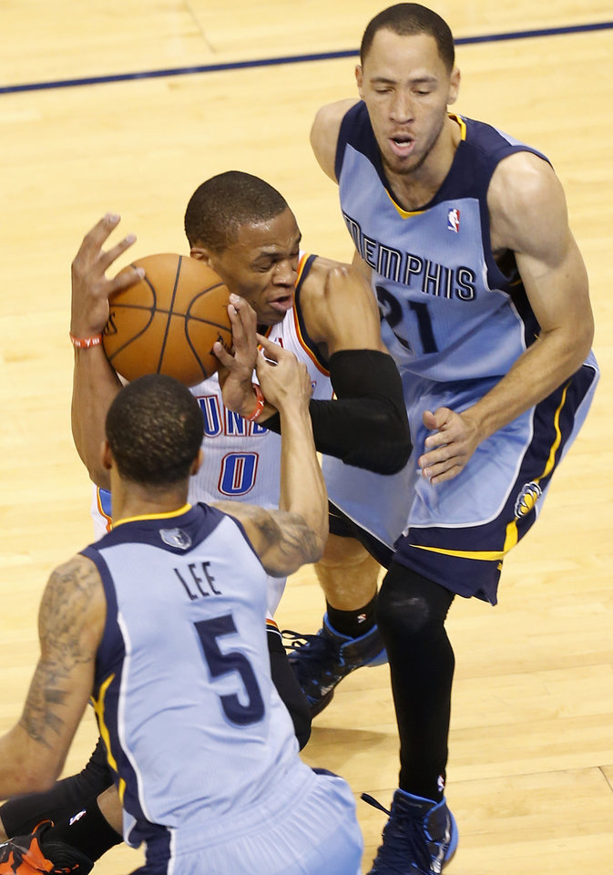 Photo - Oklahoma City's Russell Westbrook (0) is fouled as he goes between Memphis' Courtney Lee (5) and Tayshaun Prince (21) during Game 5 in the first round of the NBA playoffs between the Oklahoma City Thunder and the Memphis Grizzlies at Chesapeake Energy Arena in Oklahoma City, Tuesday, April 29, 2014. Photo by Nate Billings, The Oklahoman