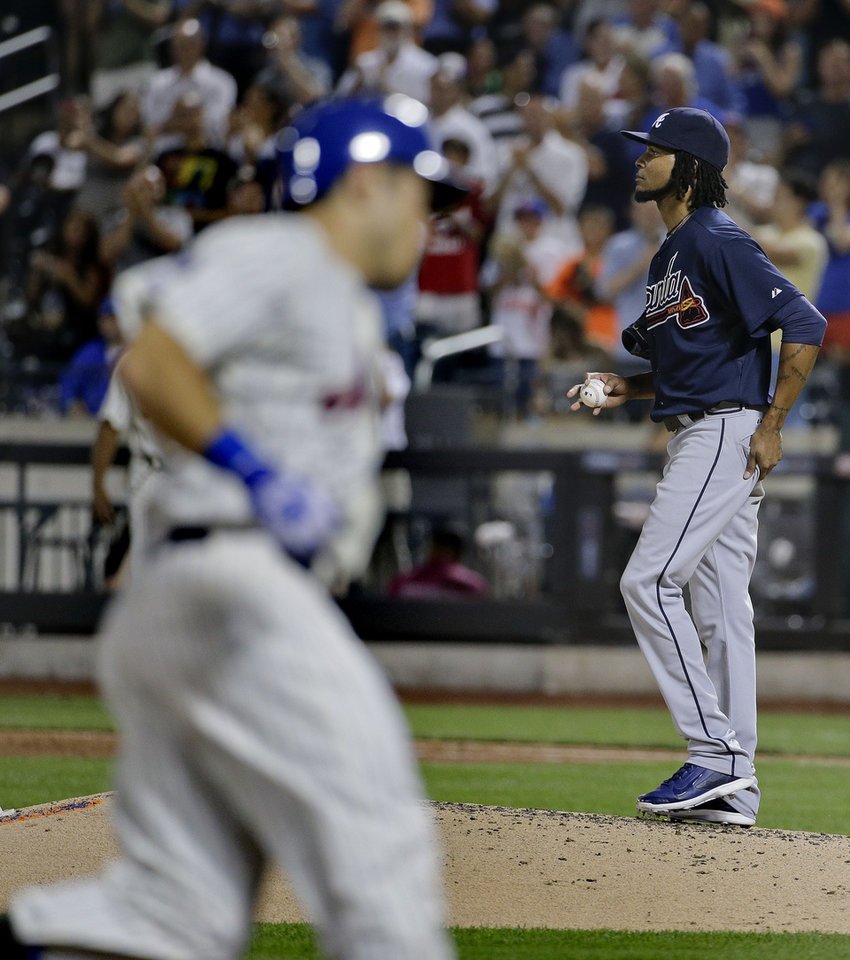 Photo - Atlanta Braves pitcher Ervin Santana (30) reacts after giving up a two-run home run against the New York Mets in the seventh inning of a baseball game, Wednesday, July 9, 2014, in New York. (AP Photo/Julie Jacobson)