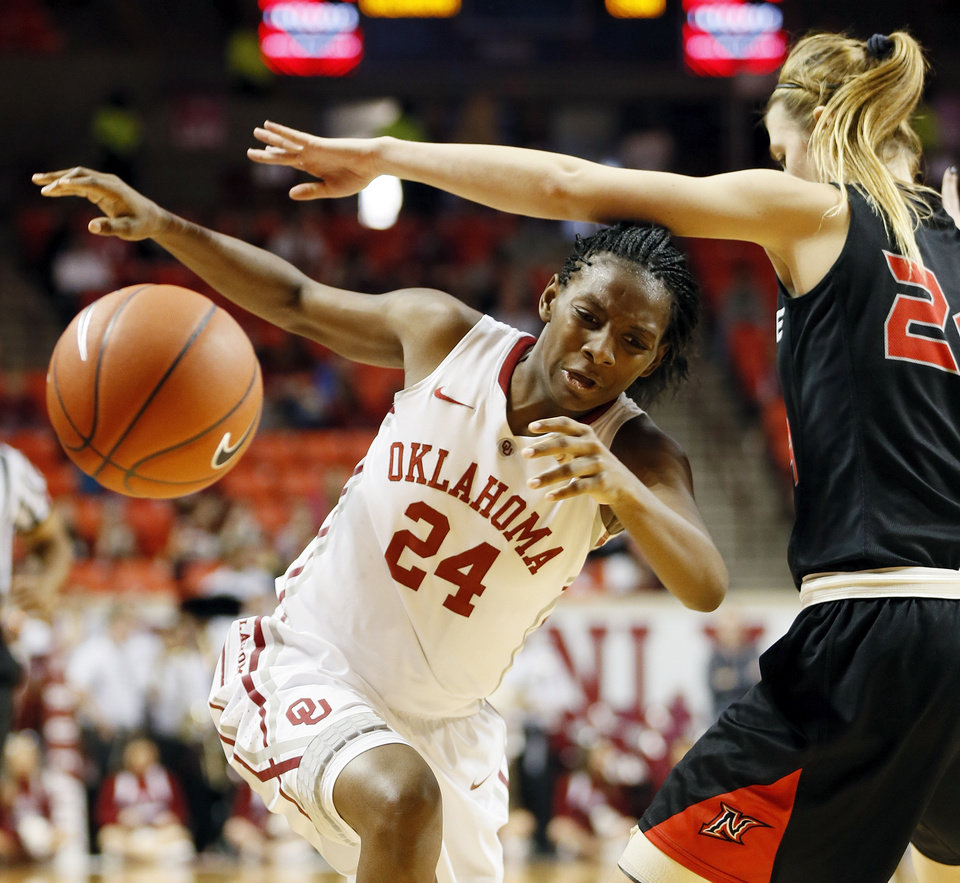 Oklahoma's Sharane Campbell (24) has the ball knocked away by Cal State Northridge's Marta Masoni (24) in the second half during a women's college basketball game between the University of Oklahoma (OU) and Cal State Northridge at the Lloyd Noble Center in Norman, Okla., Saturday, Dec. 29, 2012. OU won, 79-57.  Photo by Nate Billings, The Oklahoman
