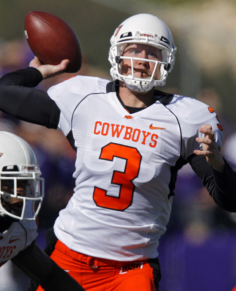 Oklahoma State quarterback Brandon Weeden (3) throws the ball during the second half of the college football game between the Oklahoma State University Cowboys (OSU) and the Kansas State University Wildcats (KSU) on Saturday, Oct. 30, 2010, in Manhattan, Kan.   Photo by Chris Landsberger, The Oklahoman