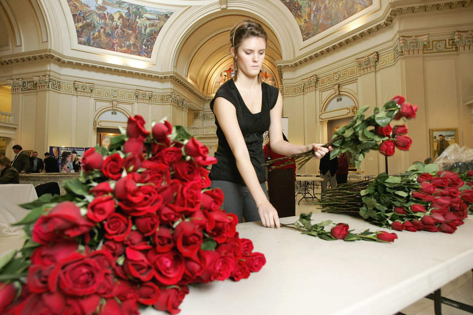 Photo - In this 2007 photo, Aubri Baker with the Baptist General Conventio of Oklahoma counts roses during Rose Day activities at the Oklahoma State Capitol. [Oklahoman Archives]