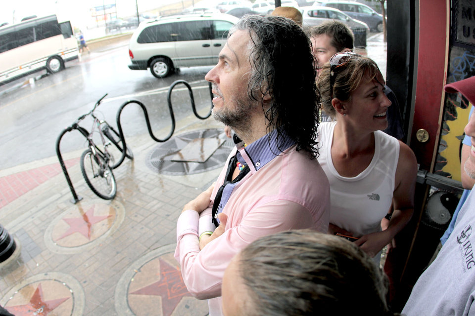 Flaming Lips lead singer Wayne Coyne seeks shelter from the weather at The Soundpony bar, 409 North Main Street, in downtown Tulsa during the Brady District Block Party. BY NATHAN POPPE, THE OKLAHOMAN