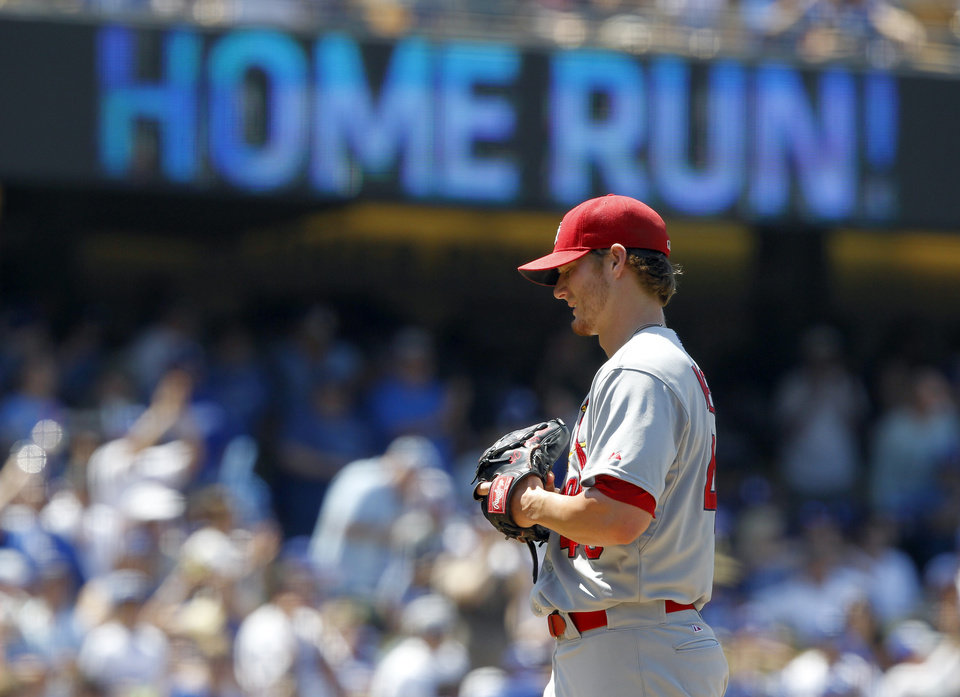 Photo - St. Louis Cardinals starting pitcher Shelby Miller regroups on the mound after giving up a three-run home run to Los Angeles Dodgers' Andre Ethier in the fifth inning of a baseball game on Sunday, June 29, 2014, in Los Angeles. (AP Photo/Alex Gallardo)