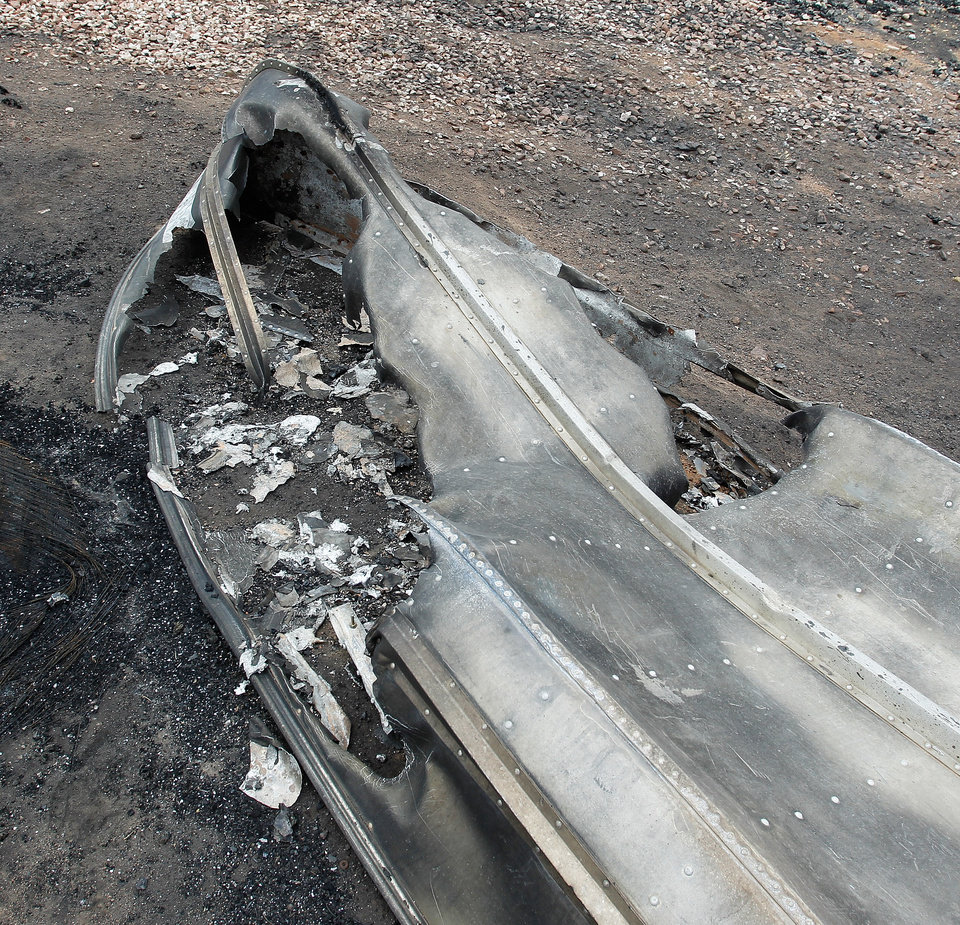 Photo - The bottom of an aluminum fishing boat is melted after being destroyed by the High Park Fire in the Glacier View residential area near Livermore, Colo., on Monday, July 2, 2012. The last evacuees from the fire in have been allowed to return home as crews fully contained the136-square-mile wildfire that killed one resident and destroyed 259 houses. (AP Photo/Ed Andrieski) ORG XMIT: COEA109